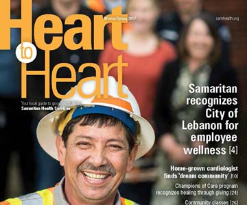 Man smiling on cover of Heart to Heart